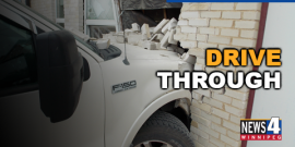 TRUCK SLAMS INTO CARMAN, MANITOBA BUSINESS