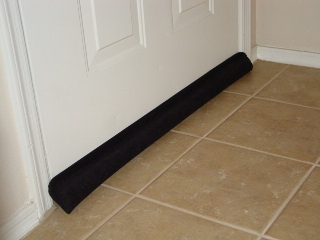 Door draft stopper used to eliminate air movement between rooms